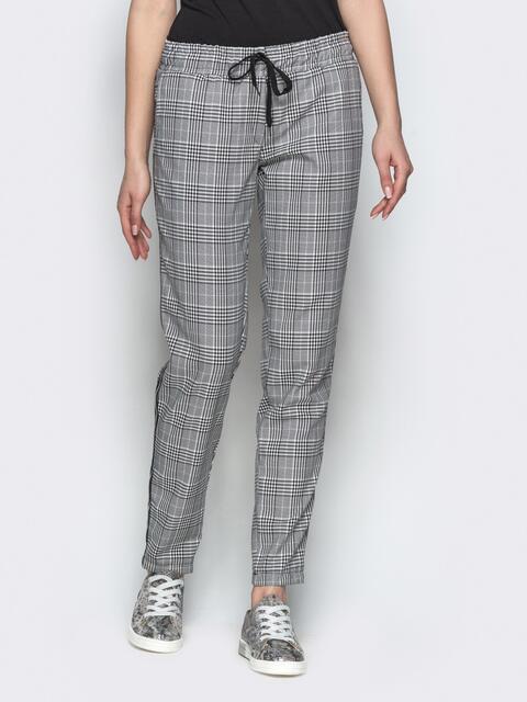 Клетчатые штаны из жаккарда с кулиской по талии и лампасом - 21847, фото 1 – интернет-магазин Dressa