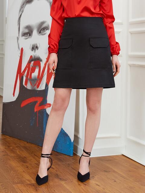 Черная юбка-трапеция из мемори-коттона с карманами 53459, фото 1