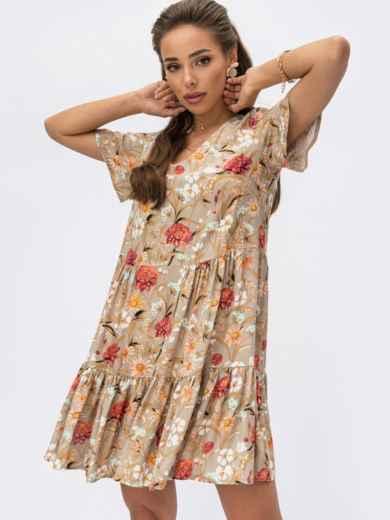 Бежевое платье-трапеция с цветочным принтом и воланом по низу 53872, фото 1