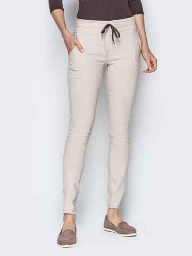Бежевые брюки с резинкой по талии и прорезными карманами 21062, фото 1